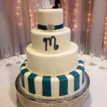 Four tiered fondant cake with quilting and stripes