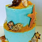 Two tiered beach themed buttercream cake with sea shells