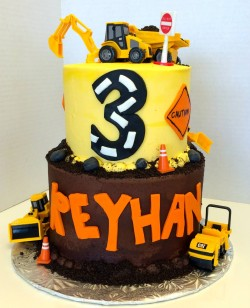 Two tiered construction themed birthday cake
