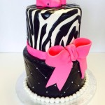 Two tiered fondant hot pink zebra themed baby shower cake