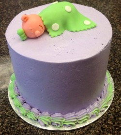 Lavender buttercream baby shower cake with sleeping baby