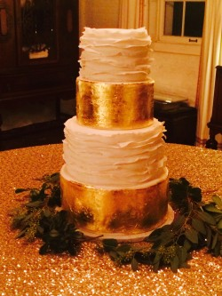 Four tiered fondant white ruffle and gold leaf cake
