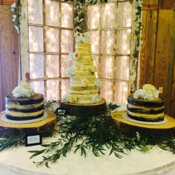 Four tiered naked cake with two naked groom's cakes and fresh flowers