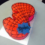Shaped spiderman themed cake