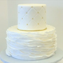 Two tiered fondant ruffle and quilted cake with gold pearls