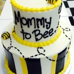 Two tiered buttercream cake with fondant decor