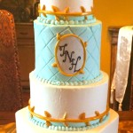 Four tiered buttercream baby shower cake