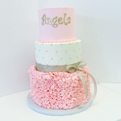 Three tiered smooth pink, white quilted buttercream and pink ruffled cake with sheer gold ribbon