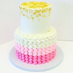 Two tiered pink ombre petal buttercream cake with gold stars