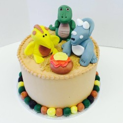 Buttercream cake with fondant dinosaurs