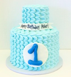 Two tiered baby blue petal buttercream first birthday cake