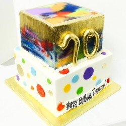 Two tiered watercolor with metallic gold and white and multicolored polka dots cake