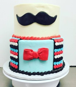 Two tiered mustache bash themed first birthday cake