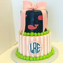 Two tiered fondant baby shower cake with monogram and bow