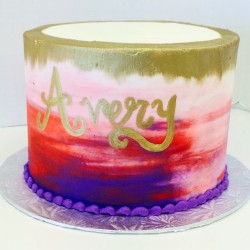Red, pink and purple watercolor cake with gold accents
