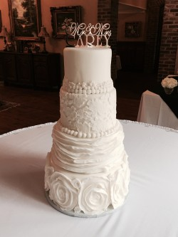 Four tiered fondant cake with different textures