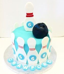 Buttercream bowling cake with fondant details