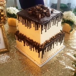 Two tiered square peanut butter and chocolate groom's cake with chocolate ganache pour