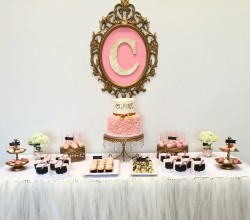 Baby shower desert table with two tiered ruffled buttercream and gold fondant name details