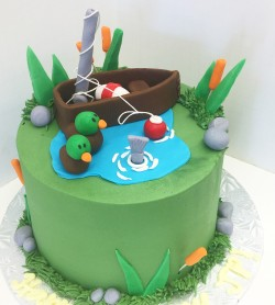 Buttercream cake with fondant fishing decor