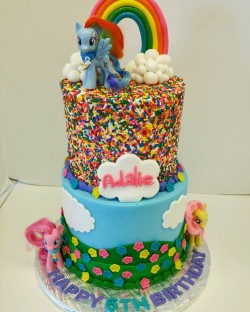 Two tiered My Little Pony cake. Buttercream with fondant decor and sprinkle covering