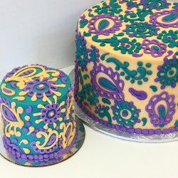 Piped paisley decorated buttercream cake with matching smash cake