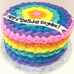 Girly rainbow rosette buttercream cake