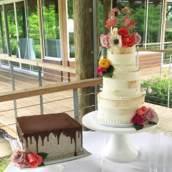 Three tiered semi naked cake fresh flowers and a Chocolate Cookies 'n' Cream groom's cake with poured chocolate ganache
